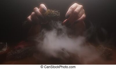 extreme close-up, detailed. hands of a witch with black nails above a bowl of thick white smoke.