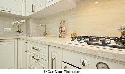 Closeup details of furniture at beige kitchen designed in ...