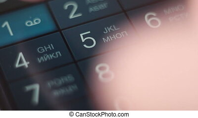 closeup dialing on smartphone, radiophone and cellphone