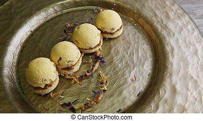 closeup exclusive dessert decorated four spherical sponge ...