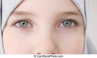 Closeup eyes of muslim girl in hijab looking at camera. -...