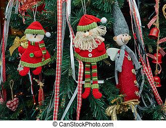Closeup fabric decorative items hung up Christmas tree