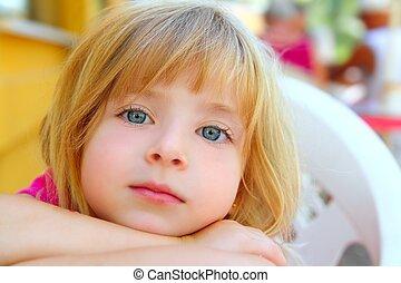 closeup face little blond girl portrait smile blue eyes