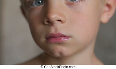 Closeup face of a little boy with a scratched nose. A wound on the face of a boy