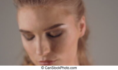 closeup face portrait of beautiful young woman