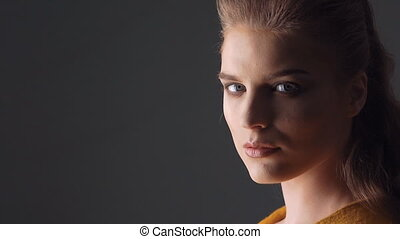closeup face portrait of beautiful young woman