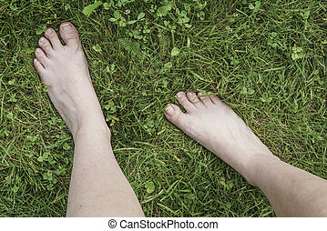 feet of a woman on grass