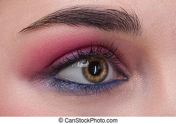 Closeup female eye with beautiful fashion bright makeup