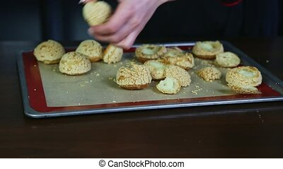 closeup female hands cut by knife custard cookies choux and ...