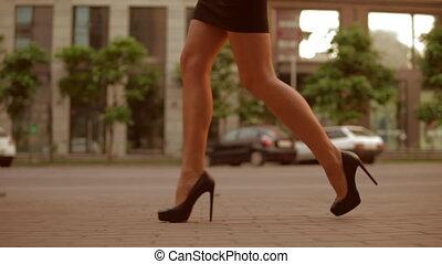 closeup female legs going on pavement