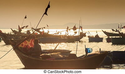 Closeup Fishing Boat Silhouettes in Sea Bay at Sunset in Vietnam