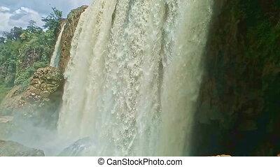 Closeup Foamy Wall of Wide Powerful Waterfall among Rocks