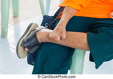 closeup foot and hand of old asian man suffering from ...