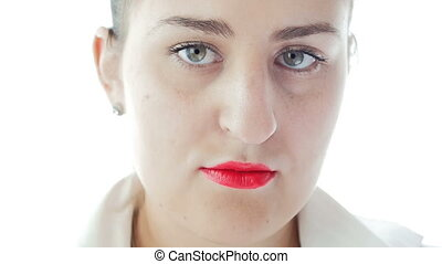Closeup footage of elegant concentrated woman with red...
