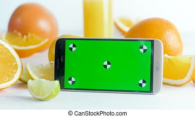 Closeup footage of smartphone with green chroma key screen...