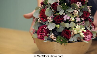 Closeup fresh flower arrangement in a steel design bowl rotating