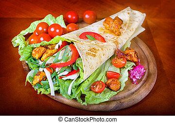 Closeup fresh tortilla on wooden tray - Healthy summer meal,...