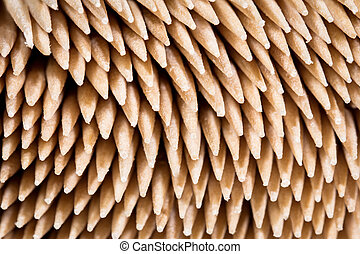 closeup from a lots of bamboo toothpicks, details from the tips
