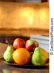 Fruit on a wooden plate
