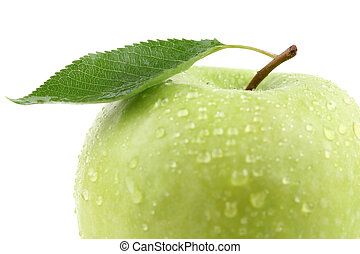 Closeup green apple fruit with leaf isolated