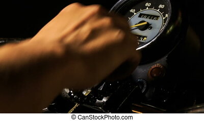 Closeup Guy Hand Switches on Motorcycle Throttle on Board -...