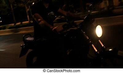 Closeup Guy in Helmet Speeds on Motorcycle along Asphalt Road