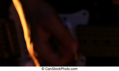Closeup Guy Plays Guitar in Low Pose in Night Bar