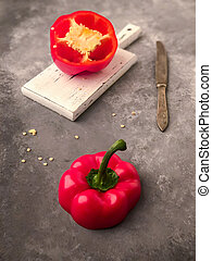 halved red bell pepper on a cutting board