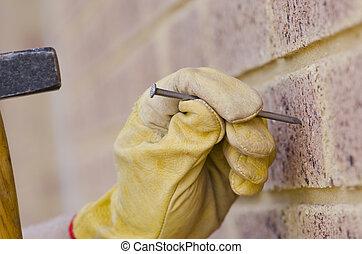 Closeup hammer nail hand renovation