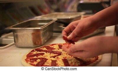 Closeup hand of chef baker in white uniform making pizza at kitchen. HD. 1920x1080