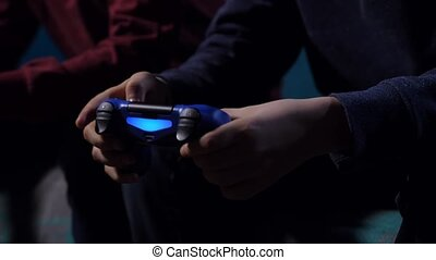 Closeup hands of boy holding game controller - Close up...
