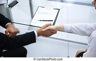 closeup. handshake of business partners on the desktop background
