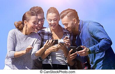 closeup. happy friends using a smartphone