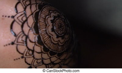 Closeup henna tattoo on woman's shoulder - Closeup freshly...