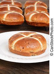 closeup hot cross bun on plate