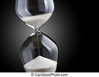 Closeup hourglass on black background