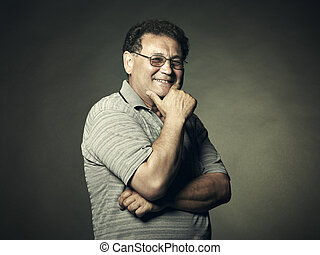 Closeup image of a happy aged man