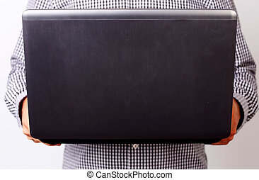 Closeup image of a man holding laptop