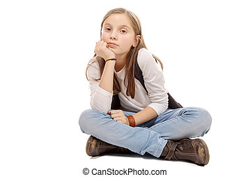 Closeup image of a pretty little girl sitting on the floor. Isolated on white background