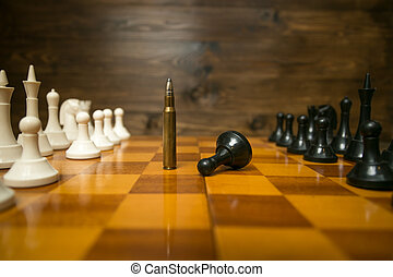 Closeup image of bullet winning in chess game. Concept of power of guns
