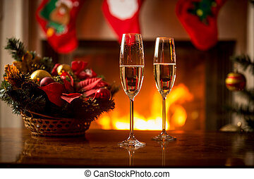 Closeup image of champagne in two glasses on Christmas table...