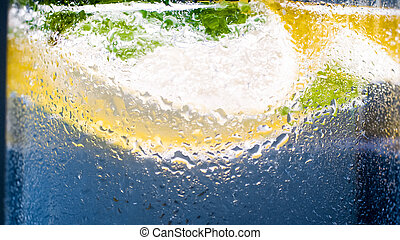 Closeup image of cold misted glass with fresh lemonade