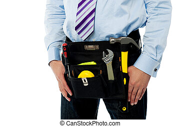 Closeup image of handyman tool belt