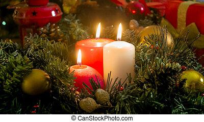 Closeup image of three burning candles on Christmas eve