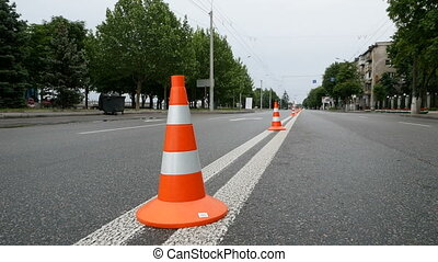 Closeup image of traffic sign - orange cone with white...
