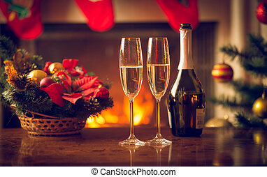Closeup image of two glasses of champagne on Christmas table