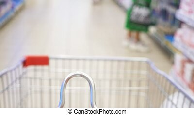 closeup in focus shopping trolley. blurred background....