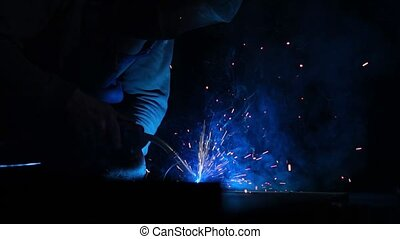 Closeup industrial Worker at the factory welding, Worker...