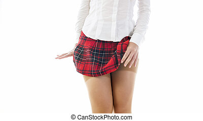 Closeup isolated photo of sexy student girl in short skirt and nylong stockings