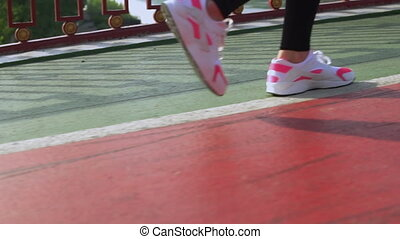 closeup jogger runs outdoors